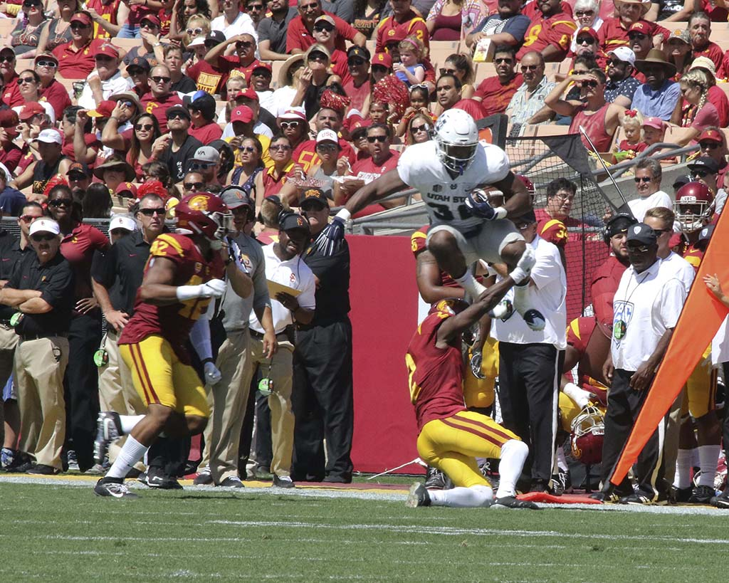 Adoree' Jackson on the tackle of flying Aggie during Utah St vs USC on Sept 10th, 2016 at Los Angeles Memorial Coliseum, in Los Angeles, Ca. (Photo by Otis Hollins Jr / fi360 News)