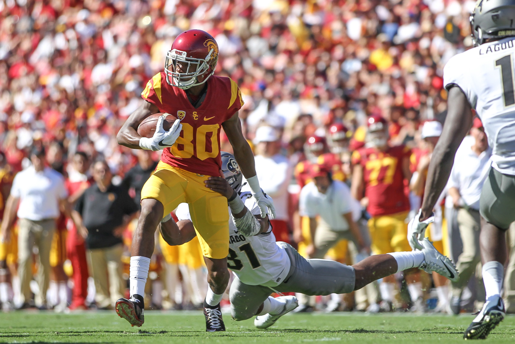 Deontay Burnett breaking away after the catch during the Colorado Buffaloes vs USC Trojans at Los Angeles Memorial Coliseum on October 8, 2016. (Photo by Jevone Moore/Full Image 360