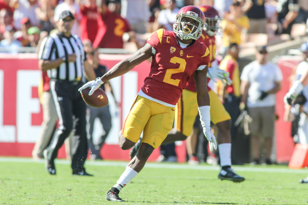 Adoree' Jackson flying with CU logo football after an interception during the Colorado Buffaloes vs USC Trojans at Los Angeles Memorial Coliseum on October 8, 2016. (Photo by Jevone Moore/Full Image 360)