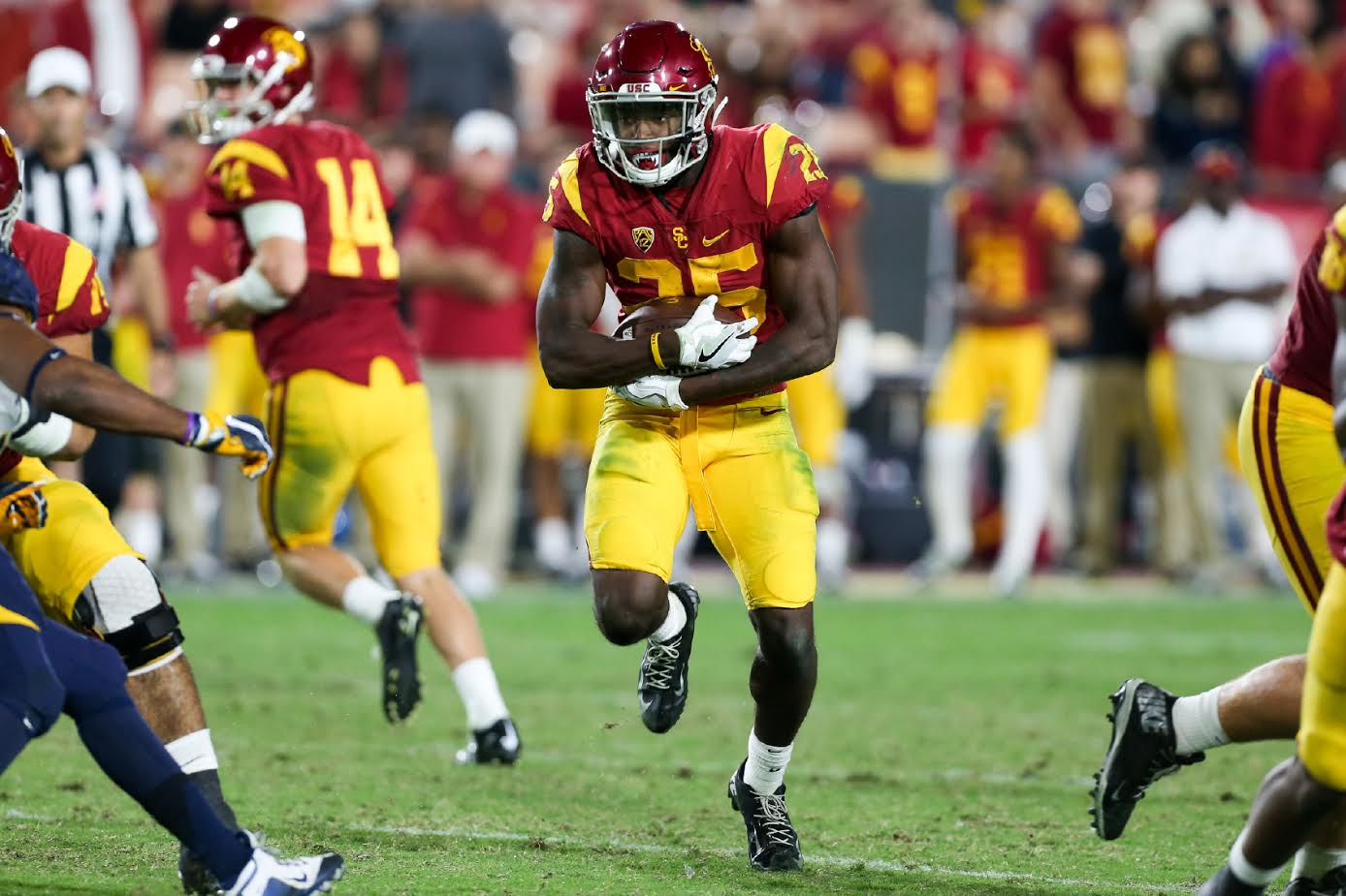 Running back Ronald Jones II goes through a hole during the Cal vs USC on Oct. 28, 2016 at Los Angeles Memorial Coliseum, in Los Angeles, Ca. (Photo by Jordon Kelly / fi360 News)