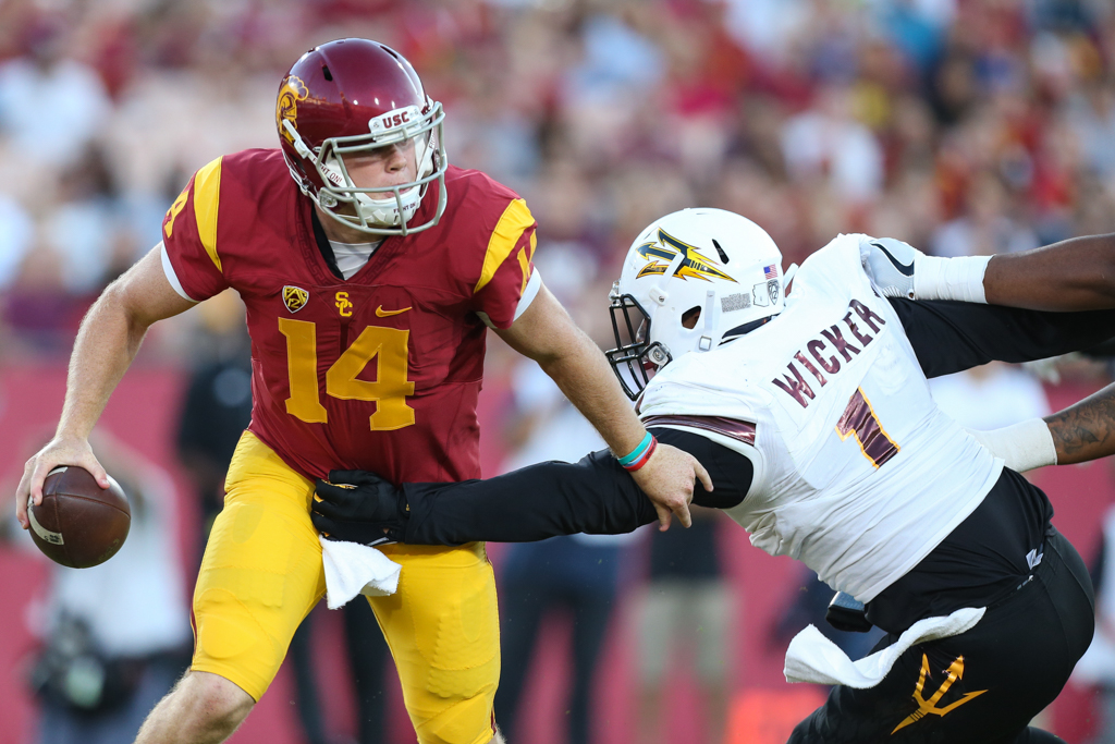 Quarterback Sam Darnold breaking away from the pressure during the Arizona St vs USC on Oct. 1, 2016 at Los Angeles Memorial Coliseum, in Los Angeles, Ca. (Photo by Jordon Kelly / fi360 News)