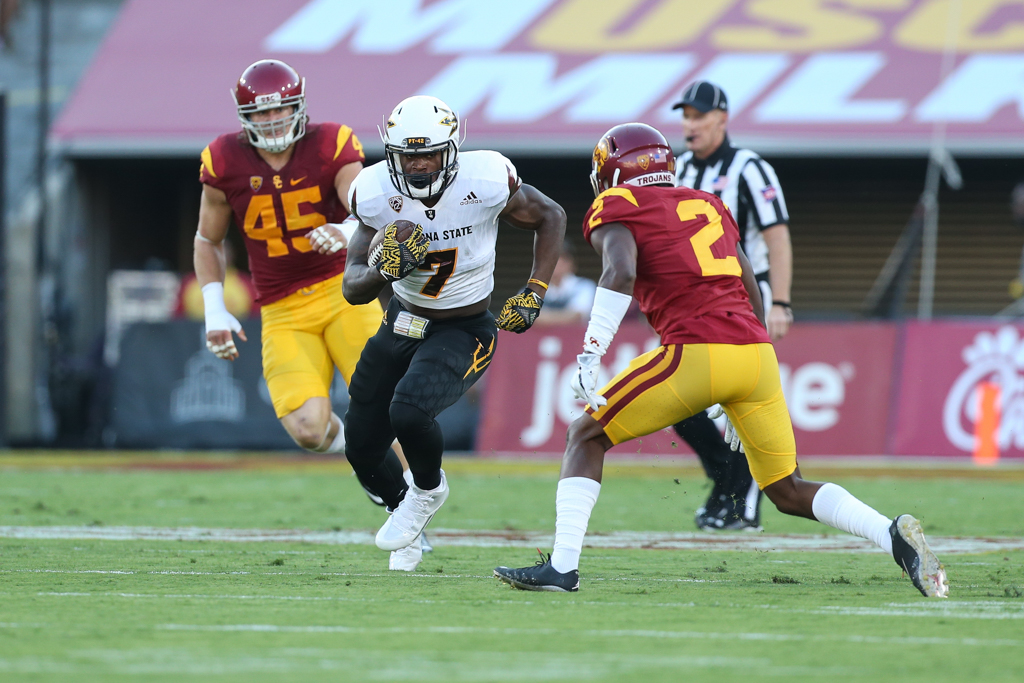 Adoree' Jackson coming up for the tackle on Kalen Ballage during the Arizona St vs USC on Oct. 1, 2016 at Los Angeles Memorial Coliseum, in Los Angeles, Ca. (Photo by Jordon Kelly / fi360 News)