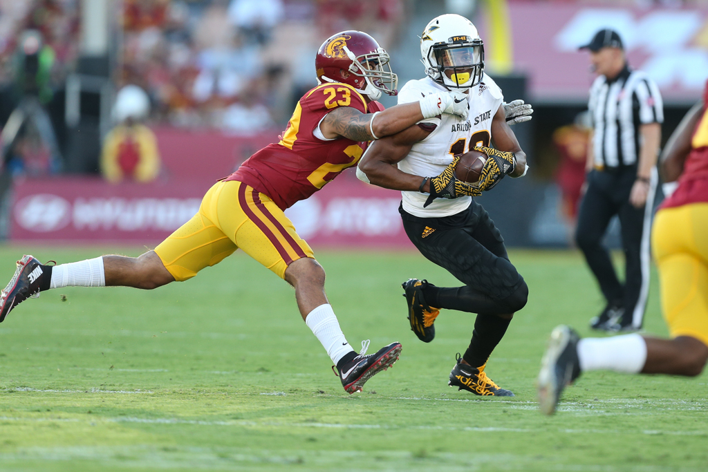 Jonathan Lockett making the tackle on Tim White during the Arizona St vs USC on Oct. 1, 2016 at Los Angeles Memorial Coliseum, in Los Angeles, Ca. (Photo by Jordon Kelly / fi360 News)