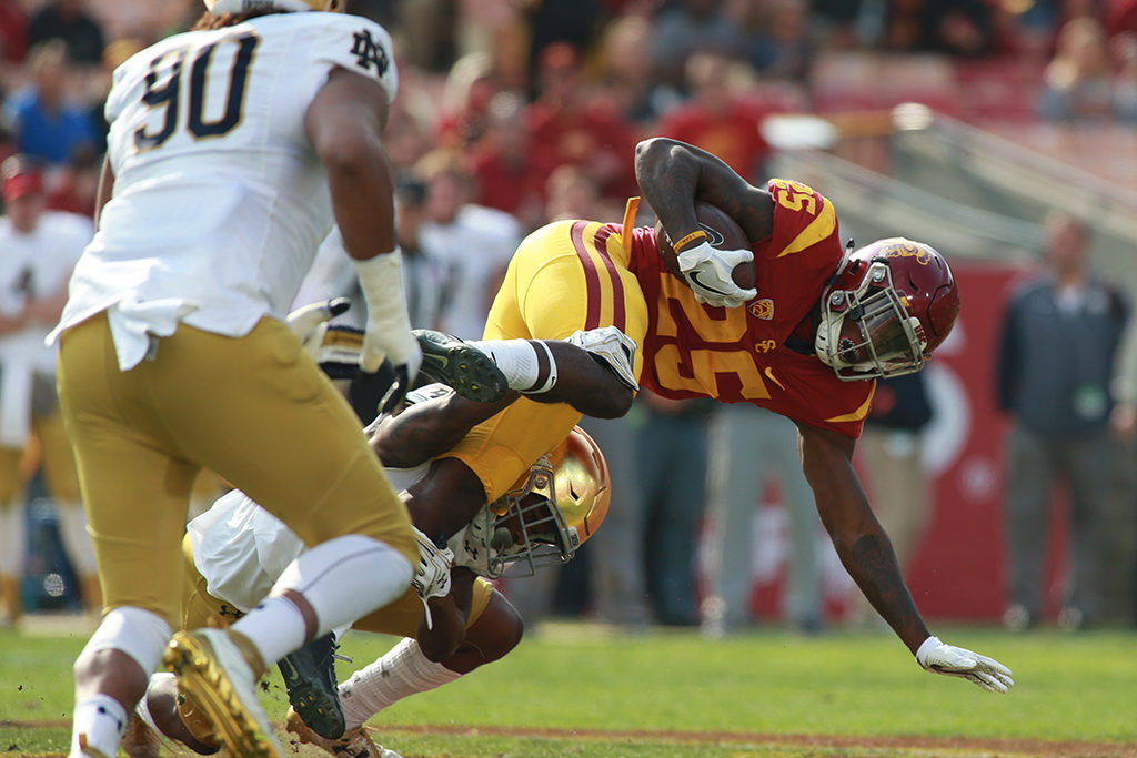 Ronald Jones II fighting for more yards during the Norte Dame vs USC Trojans at Los Angeles Memorial Coliseum on November 26, 2016. (Photo by  Jevone Moore/Full Image 360)