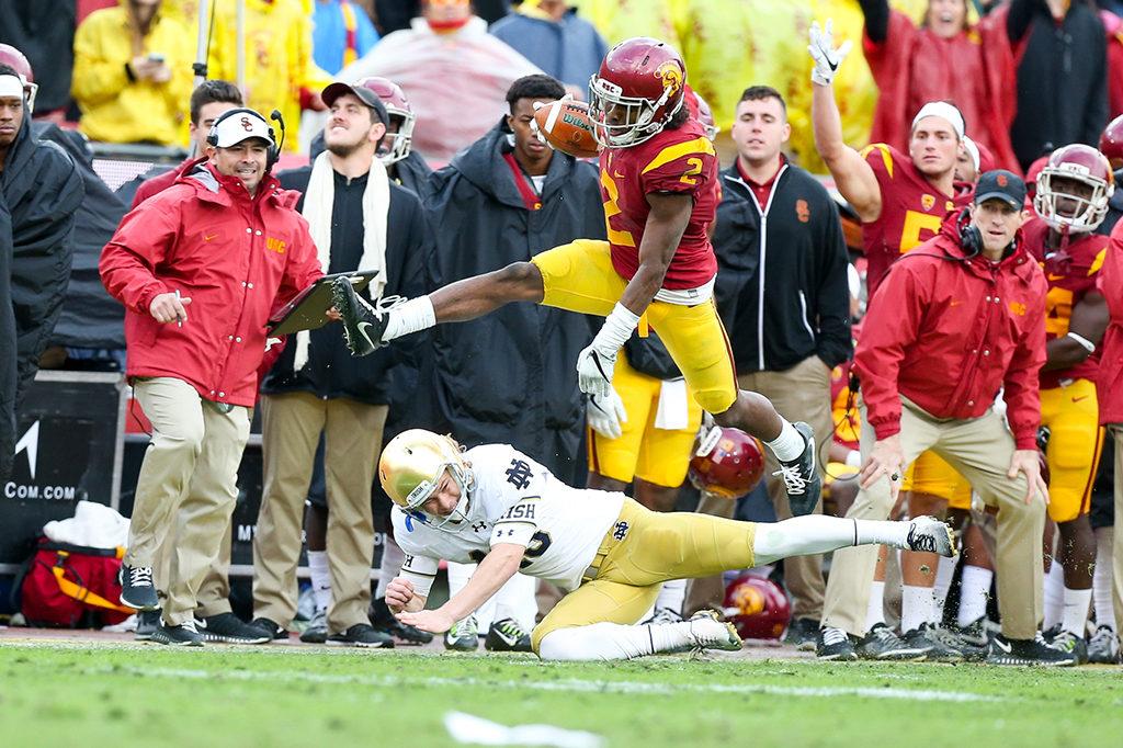 Adoree' Jackson hurdles the kicker on way to 97 yard kickoff return in the Norte Dame vs USC on Nov. 26, 2016 at Los Angeles Memorial Coliseum, in Los Angeles, Ca. (Photo by Jordon Kelly / fi360 News)