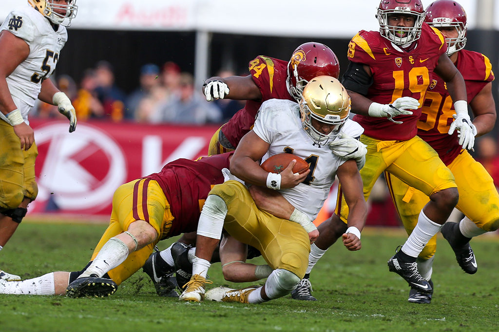 USC defense swallow up Norte Dame quarter back DeShone Kizer in the Norte Dame vs USC on Nov. 26, 2016 at Los Angeles Memorial Coliseum, in Los Angeles, Ca. (Photo by Jordon Kelly / fi360 News)