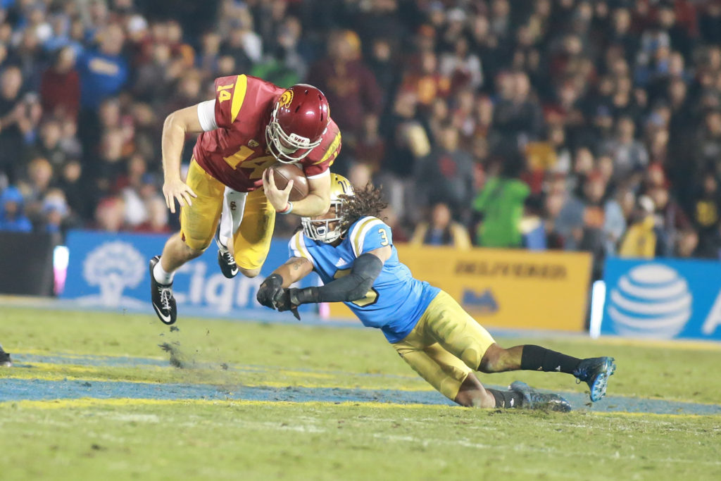 Sam Darnold going airborne after Randall Goforth tackle during the USC Trojans vs UCLA Bruins at Rose Bowl on November 19, 2016. (Photo by Jevone Moore/Full Image 360)
