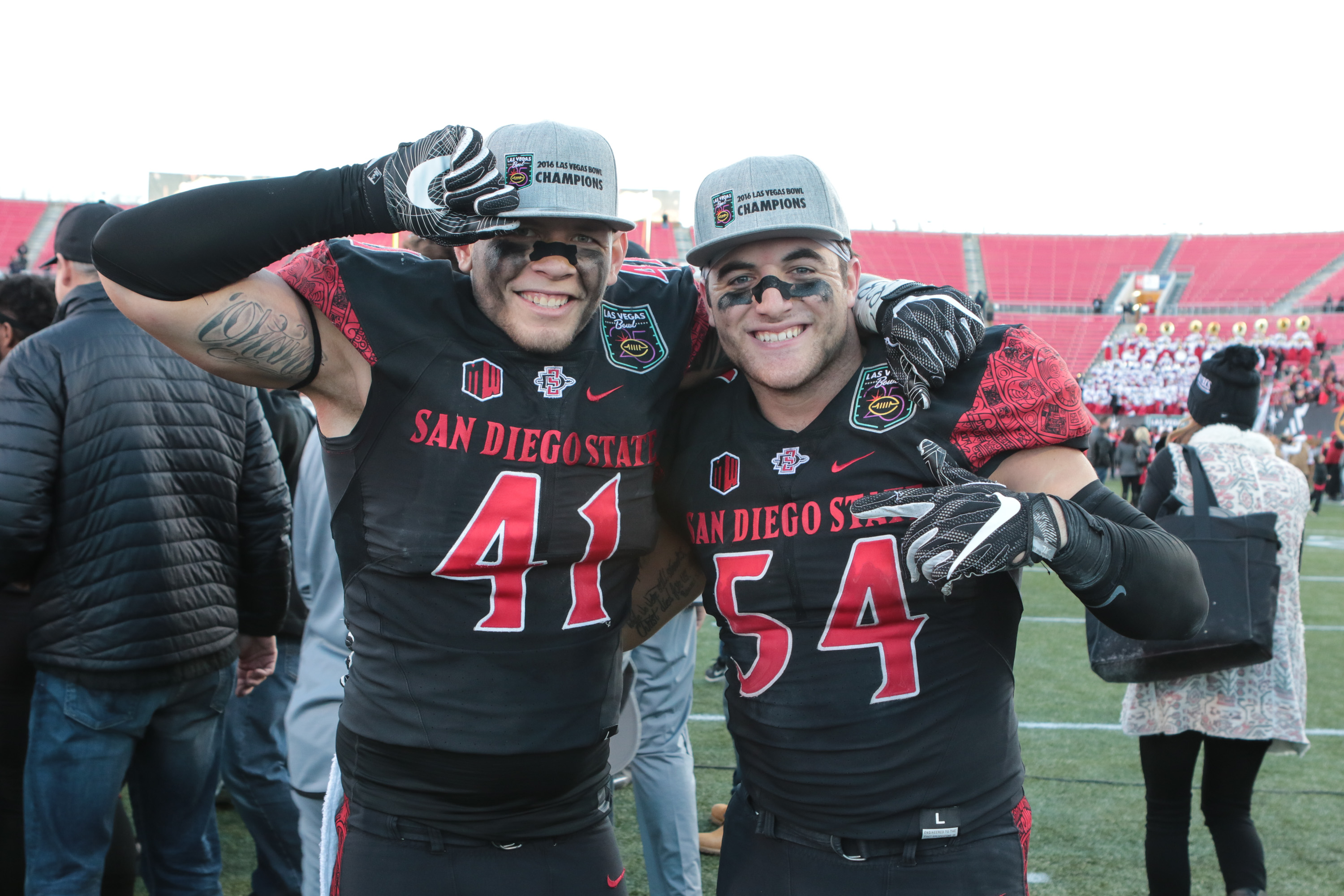 December 17, 2016 Las Vegas, NV. Dakota Turner (41), Calvin Munson (54) showing off their Las Vegas Bowl Champs hats after the 25th LAS VEGAS Bowl Houston Cougars vs San Diego State Aztecs at Sam Boyd Stadium on December 17, 2016. (Photo by Jevone Moore Full Image 360)