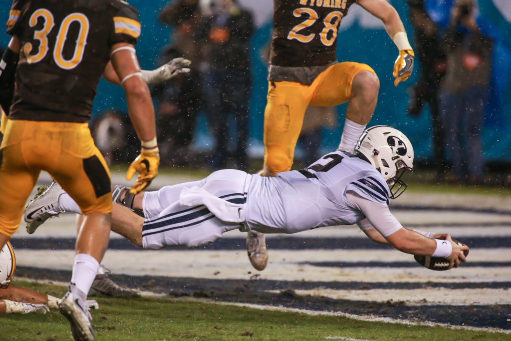 December 17, 2016 San Diego, CA Tanner Mangum (12) dives in the endzone for first touchdown in the Poinsettia Bowl: BYU Cougars vs Wyoming Cowboys at Qualcomm Stadium on December 21, 2016. (Photo by Jevone Moore / fi360 News)