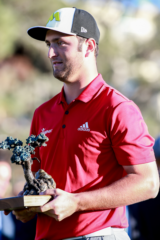 Jon Rahm with the Torrey Pines Trophy The after the Farmers Insurance Open in San Diego, CA on January 29, 2017. (Photo by Jevone Moore/Full Image 360)