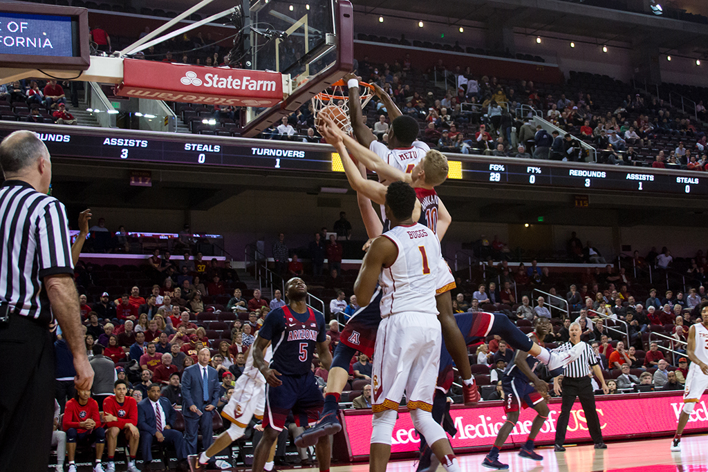 USC Metu Chimezie dunking during Arizona vs USC Trojans at Galen Center in Los Angeles, CA. (Photo by Jim Ewing /fi360 )