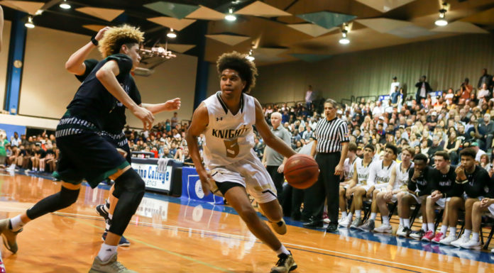 Bishop Montgomery Ethan Thompson driving on L. Ball during the CIFSS High School Semi Finals State Chino Hills vs Bishop Montgomery game on March 14, at El Camino College in Torrance, CA. (Photo by Ken Brooks /Full Image 360)