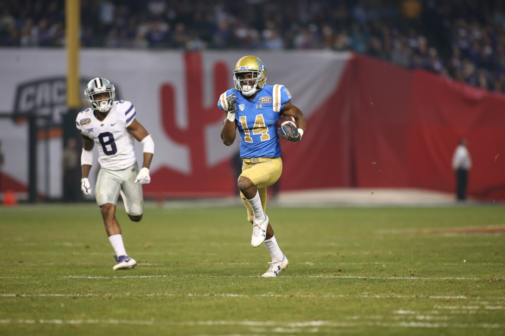 17fd861d5f9 NCAA Football Cactus 2017  Theo Howard (14) of the UCLA Bruins breaking  away during the Kansas State Wildcats vs UCLA Bruins at Chase Field