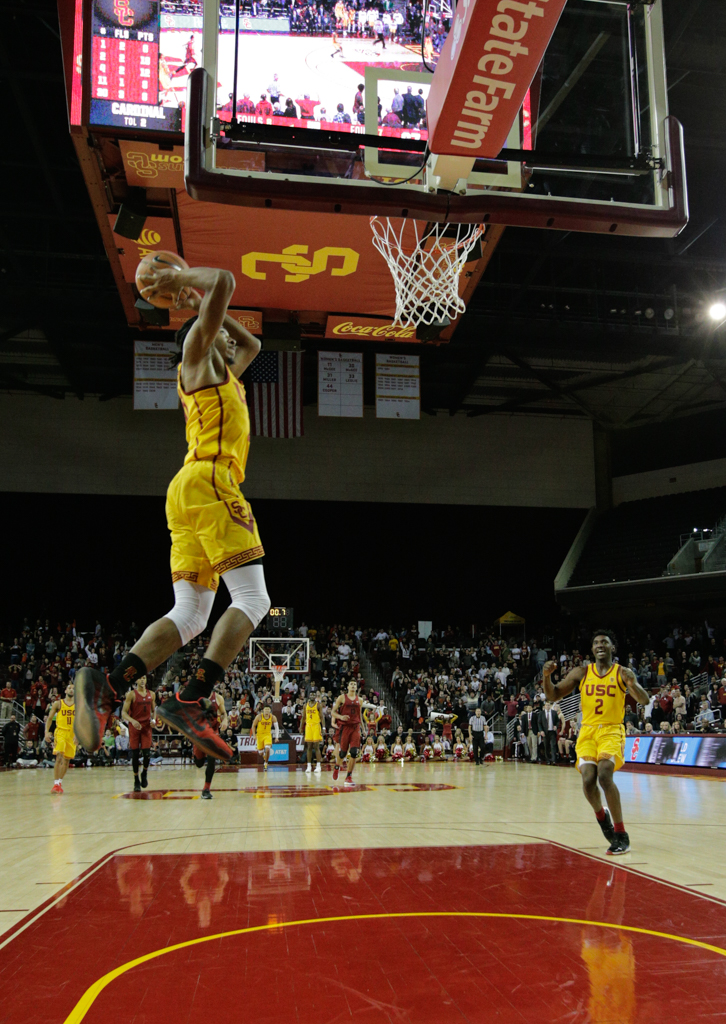 January 24, 2018 Los Angeles, CA USC Trojans (30) guard Elijah Stewart making a final slam dunk to win the game during the Stanford Trees vs USC Trojans mens basketball game at the Galen Center on January 24, 2018 . (Photo By: Daniel Bowyer / fi360 News)